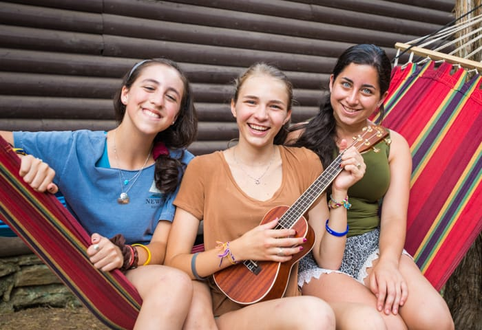 Girls on hammock with instrument