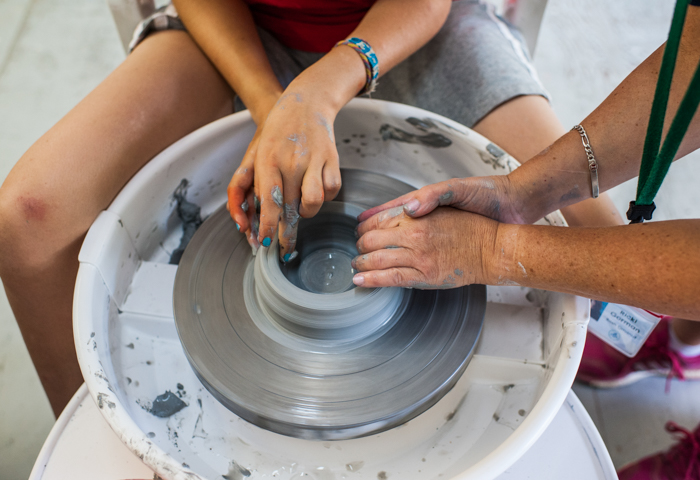 Learning to throw on a pottery wheel