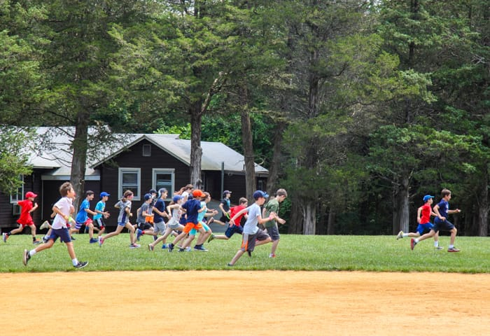 Campers exercising on field