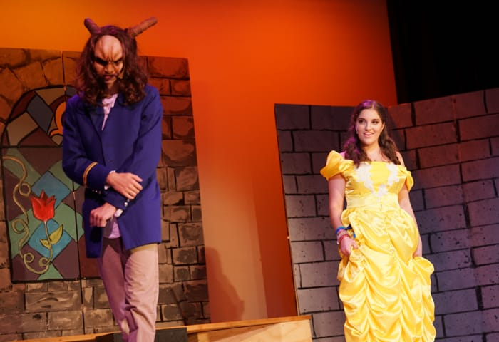 Campers acting in Beauty and the Beast play
