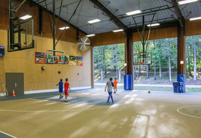 Indoor basketball court with players